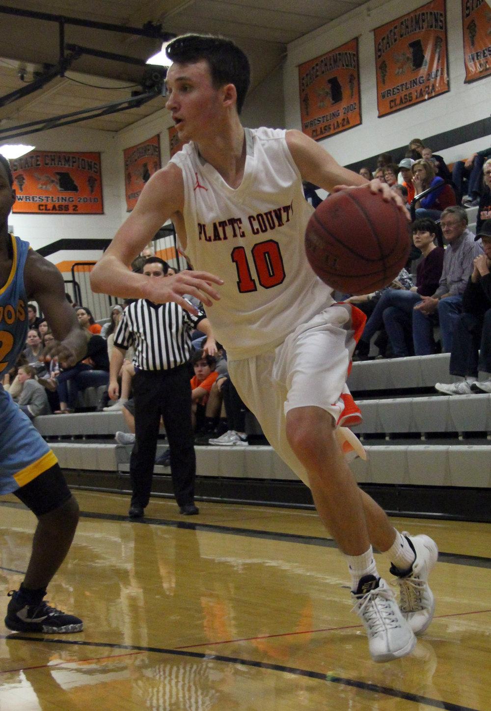 ROSS MARTIN/Citizen photo Platte County senior guard Tanner Newberry drives to basket vs. Grandview.
