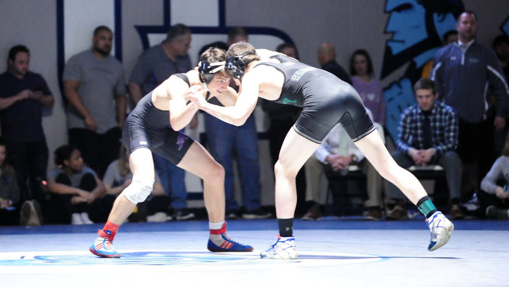 NICK INGRAM/Citizen photo Park Hill South junior Carter Thomas, left, wrestles in the 132-pound third-place match.