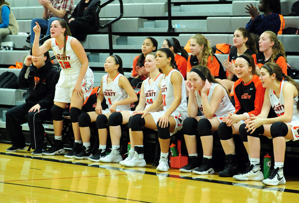 NICK INGRAM/Citizen photo Platte County senior Amy Lett (standing) reacts along with the rest of the bench during a game against Grandview on Thursday, Feb. 9 at Platte County High School.