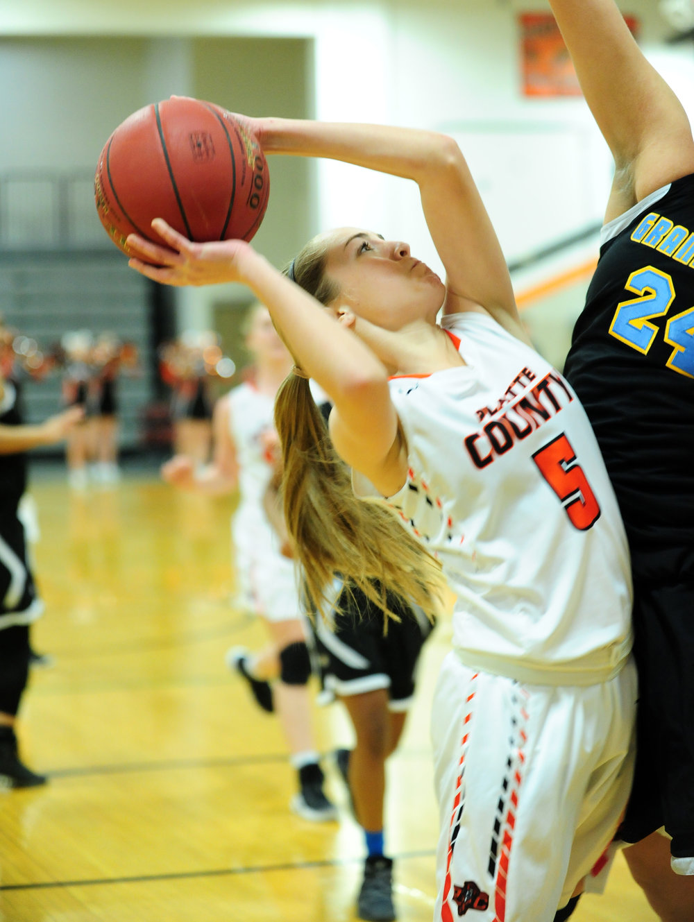 NICK INGRAM/Citizen photo Platte County sophomore guard Taylor Farr draws a foul while going up for a shot.