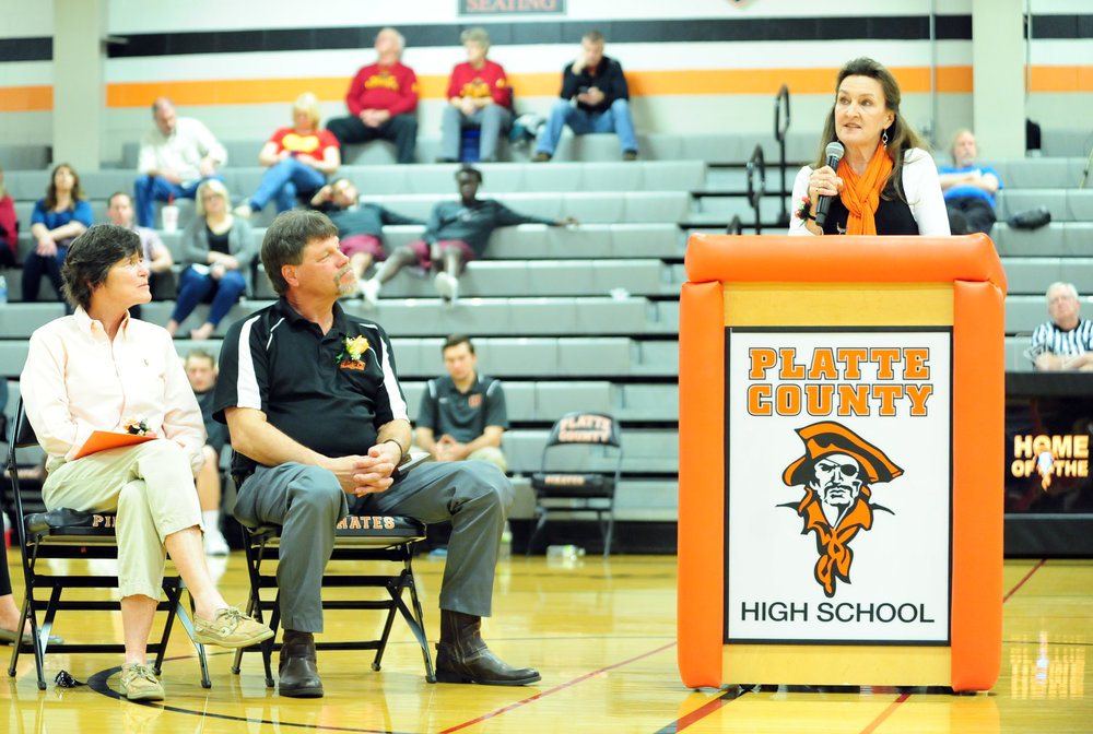 NICK INGRAM/Citizen photo Former Platte County R-3 School District staff members Jan Patterson (left) and Greg Jaros (center) and former board of education president Mary Temperelli were inducted into the Pirate Hall of Fame on Friday, Feb. 17 before the boys basketball game at Platte County High School.