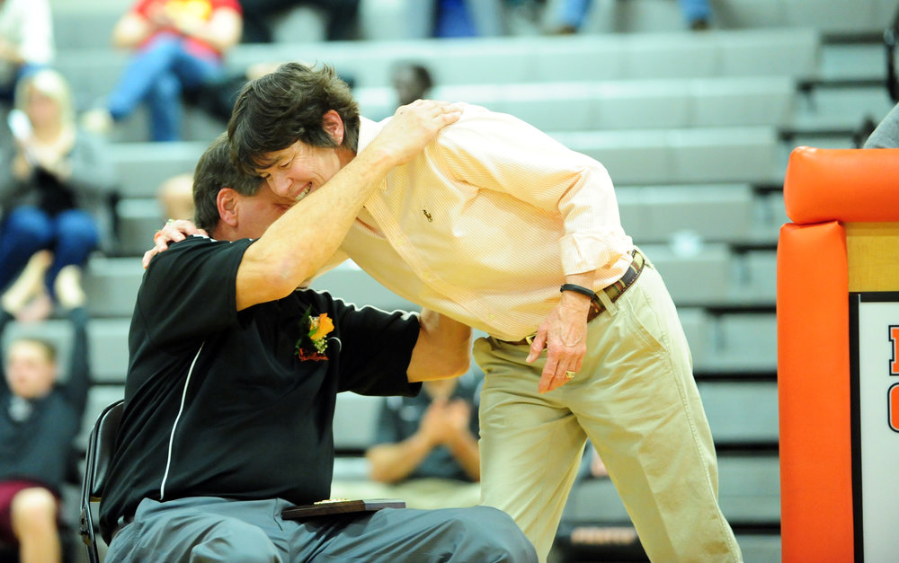 NICK INGRAM/Citizen photo Former Platte County coach and teacher Jan Patterson, right, hugs fellow Pirate Hall of Fame inductee Greg Jaros.