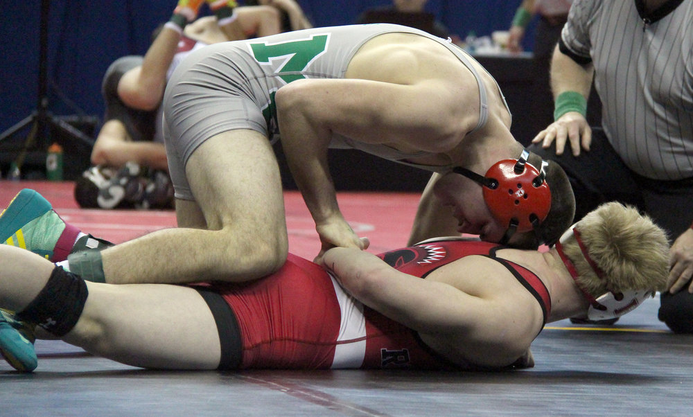 ROSS MARTIN/Citizen photo North Platte senior Parker Rotterman (top), who wrestles for Mid-Buchanan, holds down Mason Hewitt in a 152-pound first round match in the Class 1 Missouri State Wrestling Championships on Thursday, Feb. 16 at Mizzou Arena in Columbia, Mo.