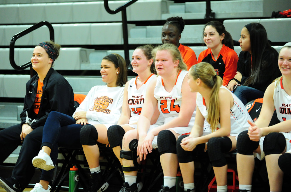 NICK INGRAM/Citizen photo Platte County seniors Ava White, Amy Lett and Liz Peterson take a seat on the bench late in a victory over Raytown South on Monday, Feb. 20 at Platte County High School.