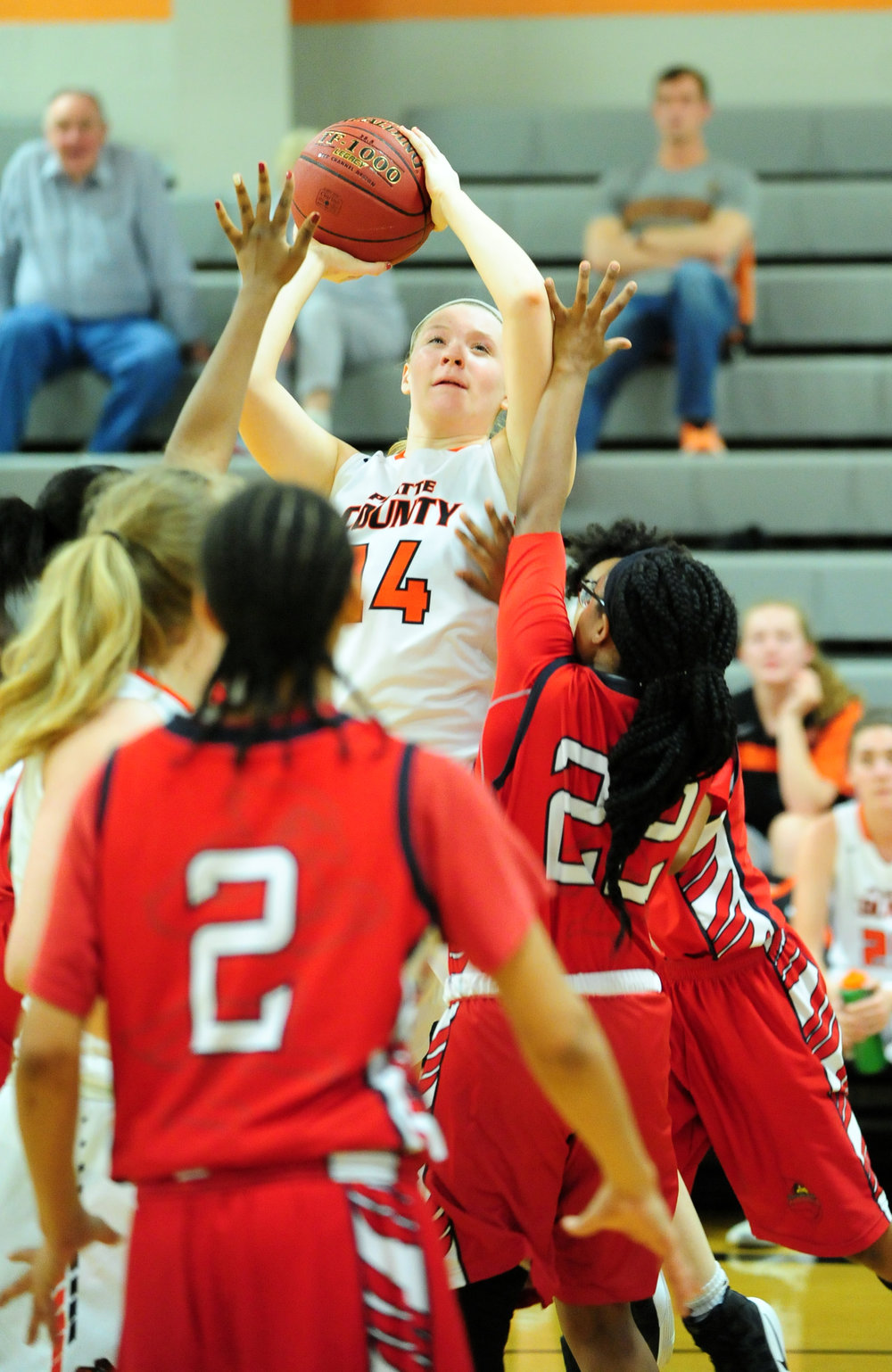 NICK INGRAM/Citizen photo Platte County junior forward Lauren Walker takes a shot over the Raytown defense on Monday, Feb. 20 at Platte County High School.