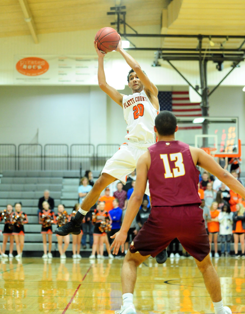 NICK INGRAM/Citizen photo Platte County senior guard DeAndre Rollins goes high to collect a pass against Winnetonka on Friday, Feb. 17 at Platte County High School.