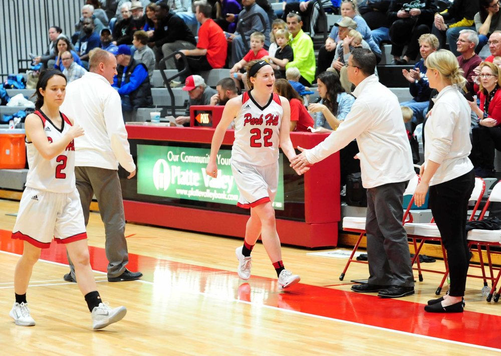 NICK INGRAM/Citizen photo Park Hill seniors Alex Berger (22) and Andie Powell (2) leave the floor late in the Trojans' win against Oak Park in a Class 5 District 16 semifinal Monday, Feb. 27 at Park Hill High School in Kansas City, Mo..
