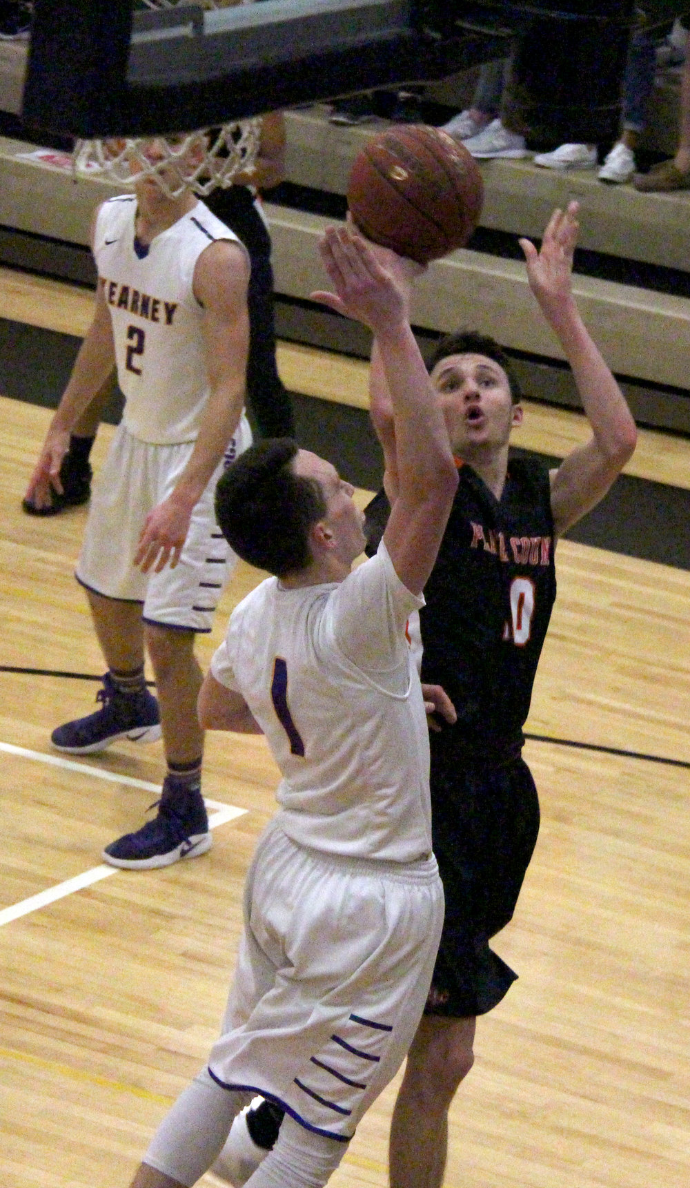 ROSS MARTIN/Citizen photo Platte County senior guard Tanner Newberry, right, goes up for a shot against Kearney senior Dylan Ritz (1) during the Class 4 District 15 title game Saturday, March 4 at Excelsior Springs High School in Excelsior Springs, Mo.