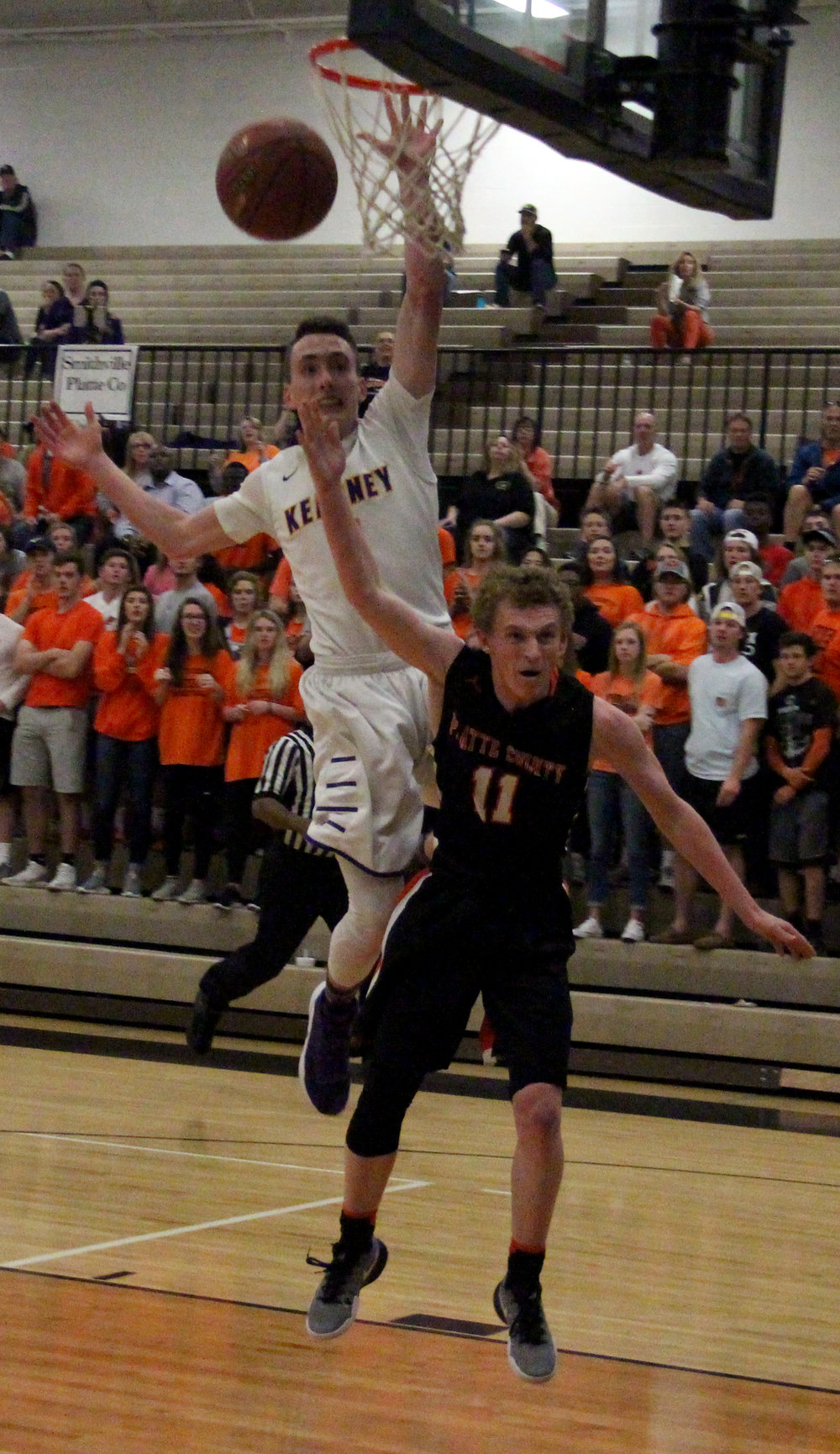 ROSS MARTIN/Citizen photo Platte County junior JP Post (11) takes a foul from Kearney senior Dylan Ritz late in the second half of the Class 4 District 15 title game Saturday, March 4 in Excelsior Springs, Mo.