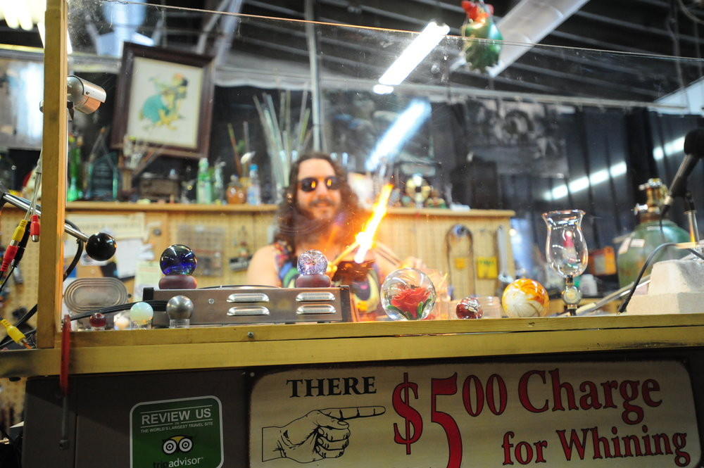 NICK INGRAM/Citizen photo Glass artist Jes Durfee from Duluth, Minn. uses a propane torch to demonstrate his technique for creating a marble as a work of art during the Moon Marble Crazy event on Saturday, March 4 at the Moon Marble Company located in Bonner Springs, Kan. Bruce Breslow, a Platte City resident, is the owner of the unique business that sells marbles and traditional games.