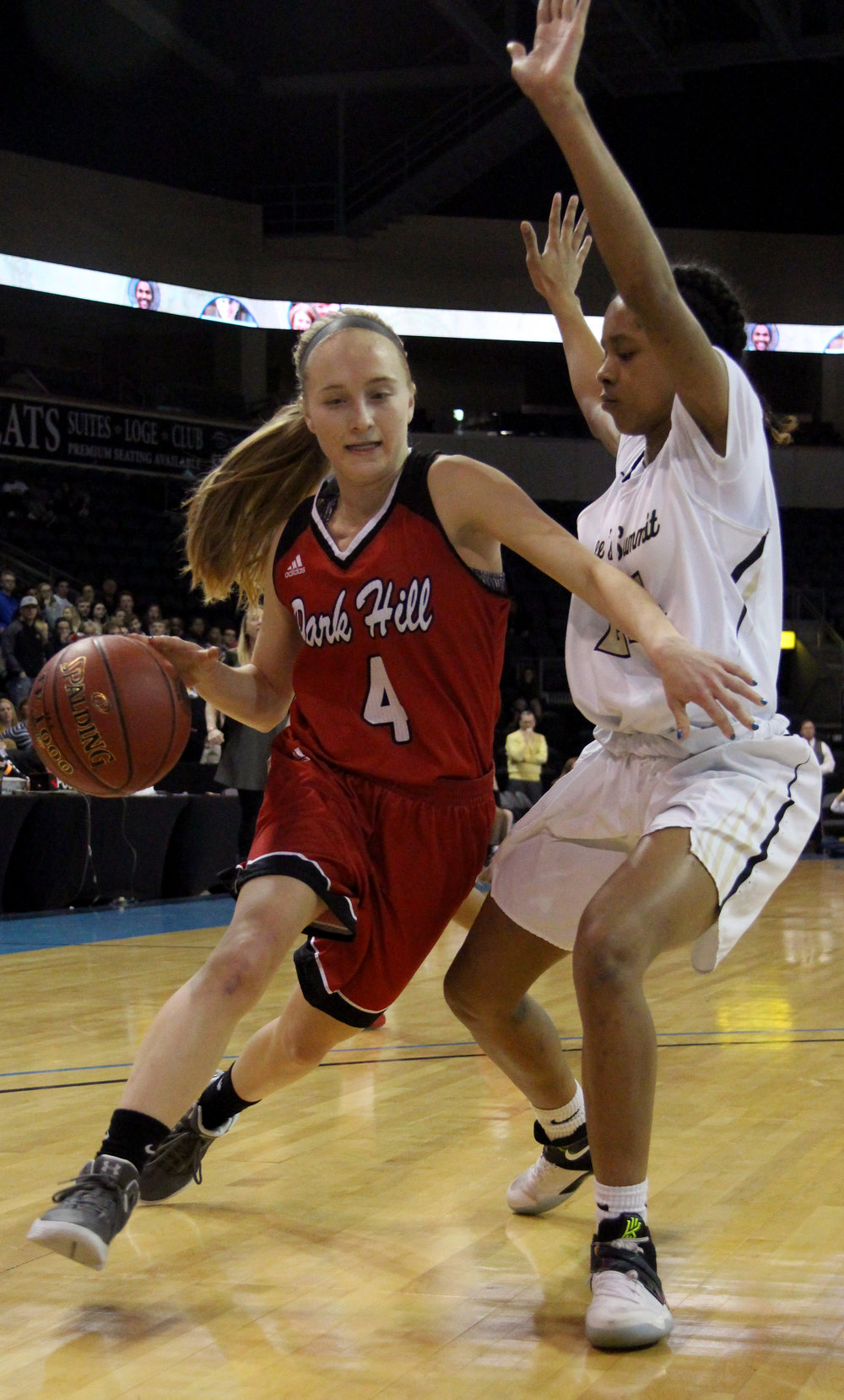 ROSS MARTIN/Citizen photo Park Hill junior guard Alison Walls, left, dribbles around a Lee's Summit defender in a Class 5 quarterfinal matchup Saturday, March 11 in Independence, Mo.
