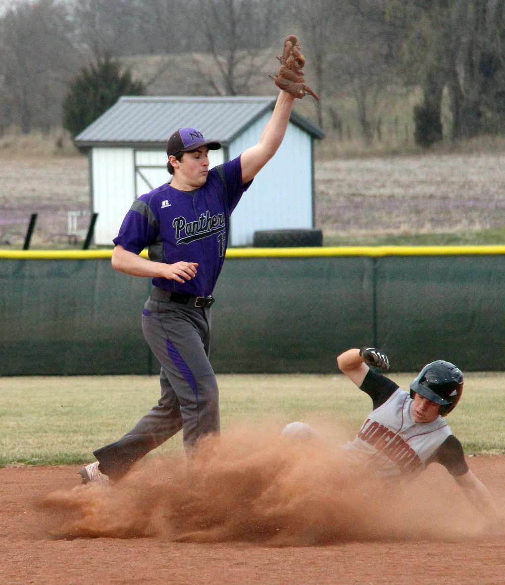 ROSS MARTIN/Citizen photo North Platte second baseman Remington Wilson records an out as a Platte Valley runner slides into second base on Monday, March 20 at Dean Park in Dearborn, Mo.