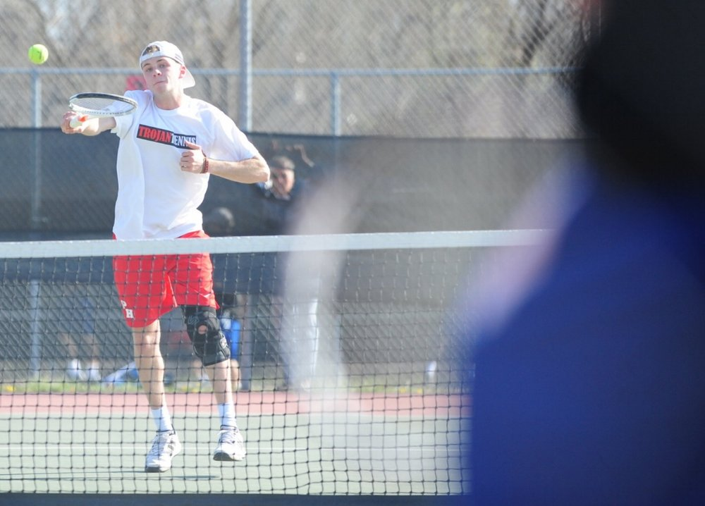 NICK INGRAM/Citizen photo Park Hill senior Jake McFee, left, hits a return shot during a doubles match against Liberty on Thursday, March 23 at Barry Park in Kansas City, Mo.