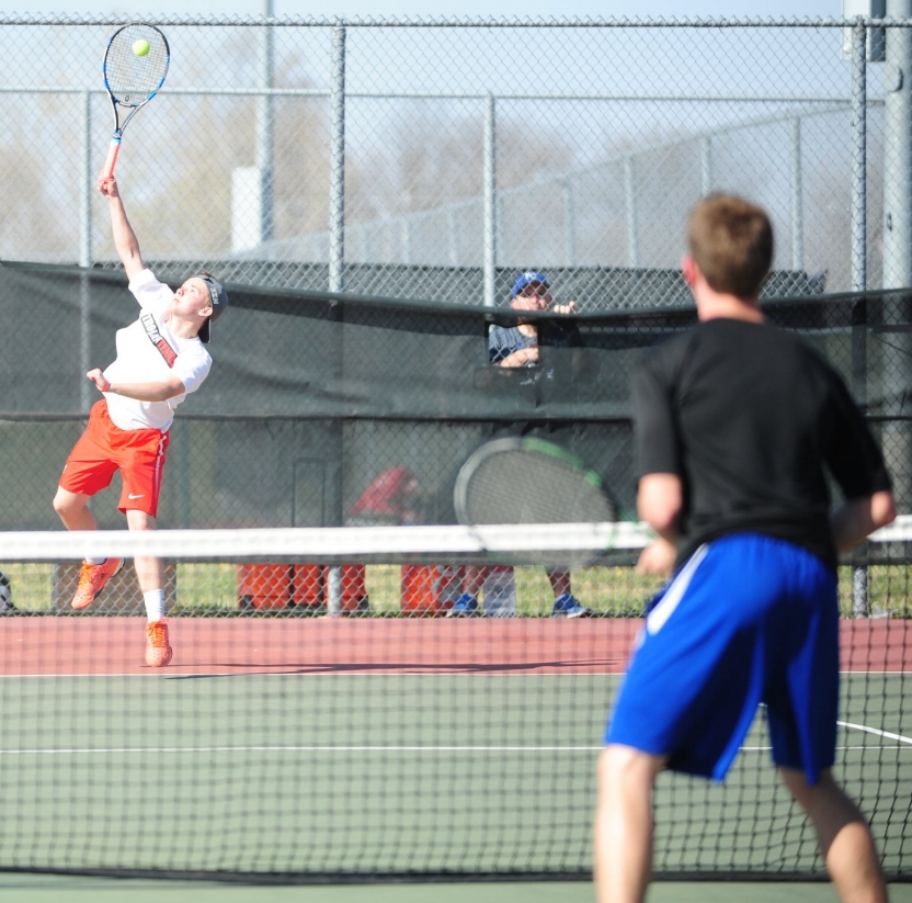 NICK INGRAM/Citizen photo Park Hill senior Ryan Decker left, hits a serve during a singles match in a dual against Liberty on Thursday, March 23 at Barry Park in Kansas City, Mo.