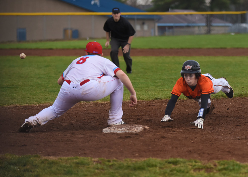 TODD NUGENT/Special to The Citizen Platte County's Ryan Frazier, right, dives back into first base in a game against Glendale on Friday, March 24 in Springfield, Mo. The game was part of the Willard Tournament, which ended up canceled due to inclement weather.