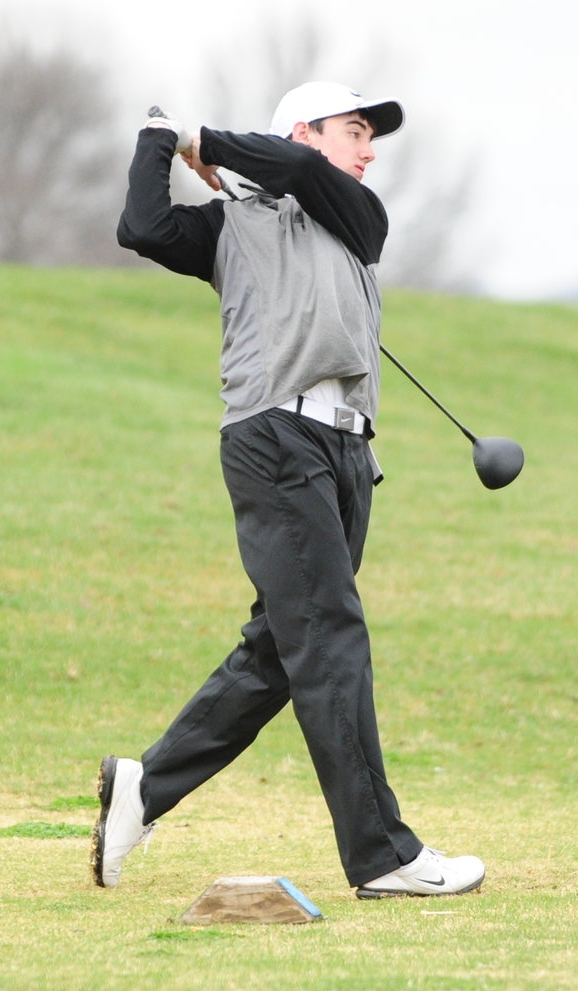 NICK INGRAM/Citizen photo Platte County freshman Logan Hessemeyer watches a tee shot during a nine-hole dual with North Kansas City on Monday, March 27 at Shiloh Springs Golf Course in Platte City.