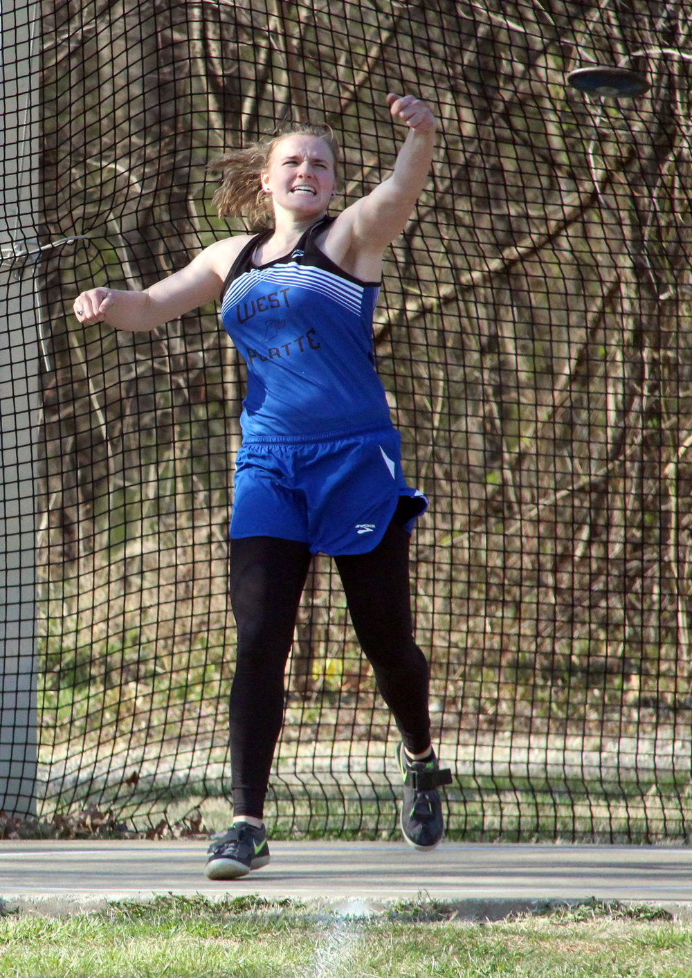 ROSS MARTIN/Citizen photo West Platte senior Sydney Oberdiek tosses the discus during the North Platte Early Bird meet held Thursday, March 23 at the new Rudolph Eskridge Stadium in Weston, Mo. The meet was the first at the newly constructed facility.