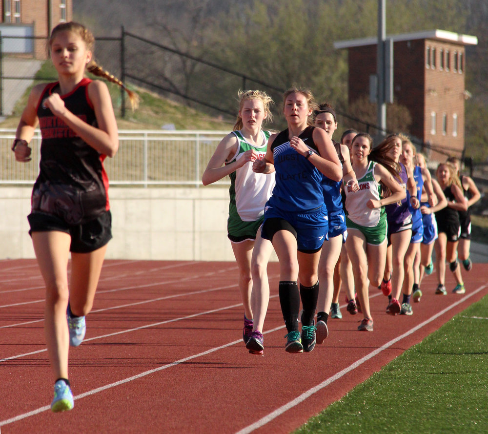 ROSS MARTIN/Citizen photo Northland Christian's Carly Smith, left, leads a pack of runners with West Platte junior Rachel Heili at the front during the 1,600-meter run.