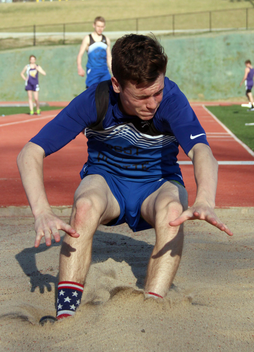 ROSS MARTIN/Citizen photo ABOVE: West Platte junior Gavin Raney hits the sand during the triple jump competition.