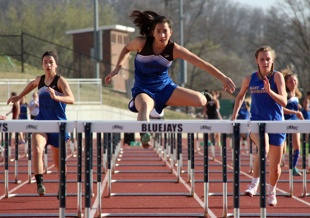 ROSS MARTIN/Citizen photo West Platte's Tori Norman, center, leads her 100-meter hurdles heat during the North Platte Early Bird meet held Thursday, March 23 at the new Rudolph Eskridge Stadium in Weston, Mo.