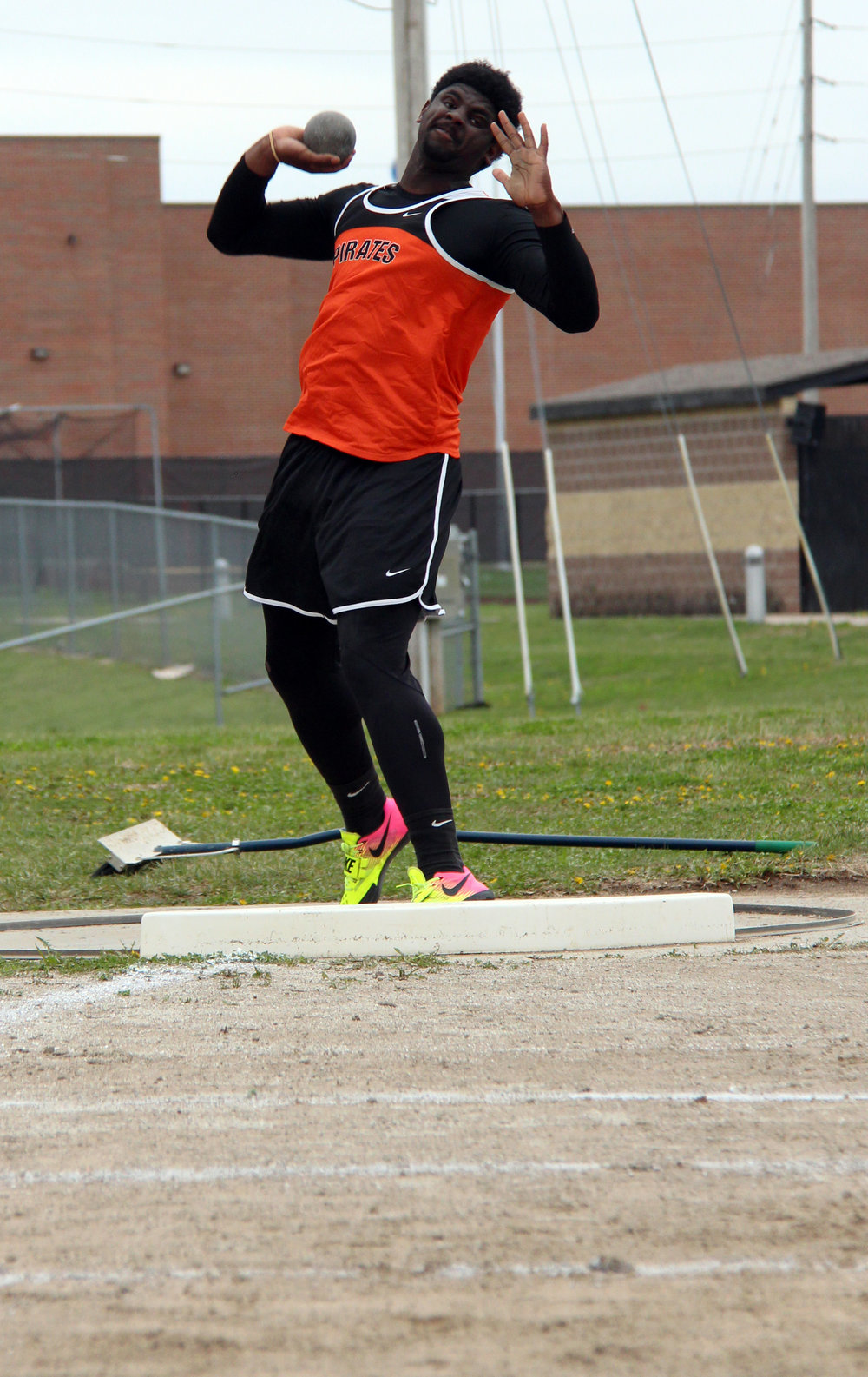 ROSS MARTIN/Citizen photo Platte County sophomore Xavier Keith takes an attempt in the shot put during Pirate Flight Night on Friday, March 31 at Pirate Stadium.