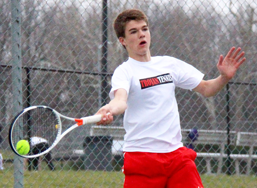 ROSS MARTIN/Citizen photo Park Hill sophomore Cooper Hayes hits a forehand in a match against Park Hill South's Joe Badalucco in a dual Thursday, March 30 at Park Hill South High School in Riverside, Mo.