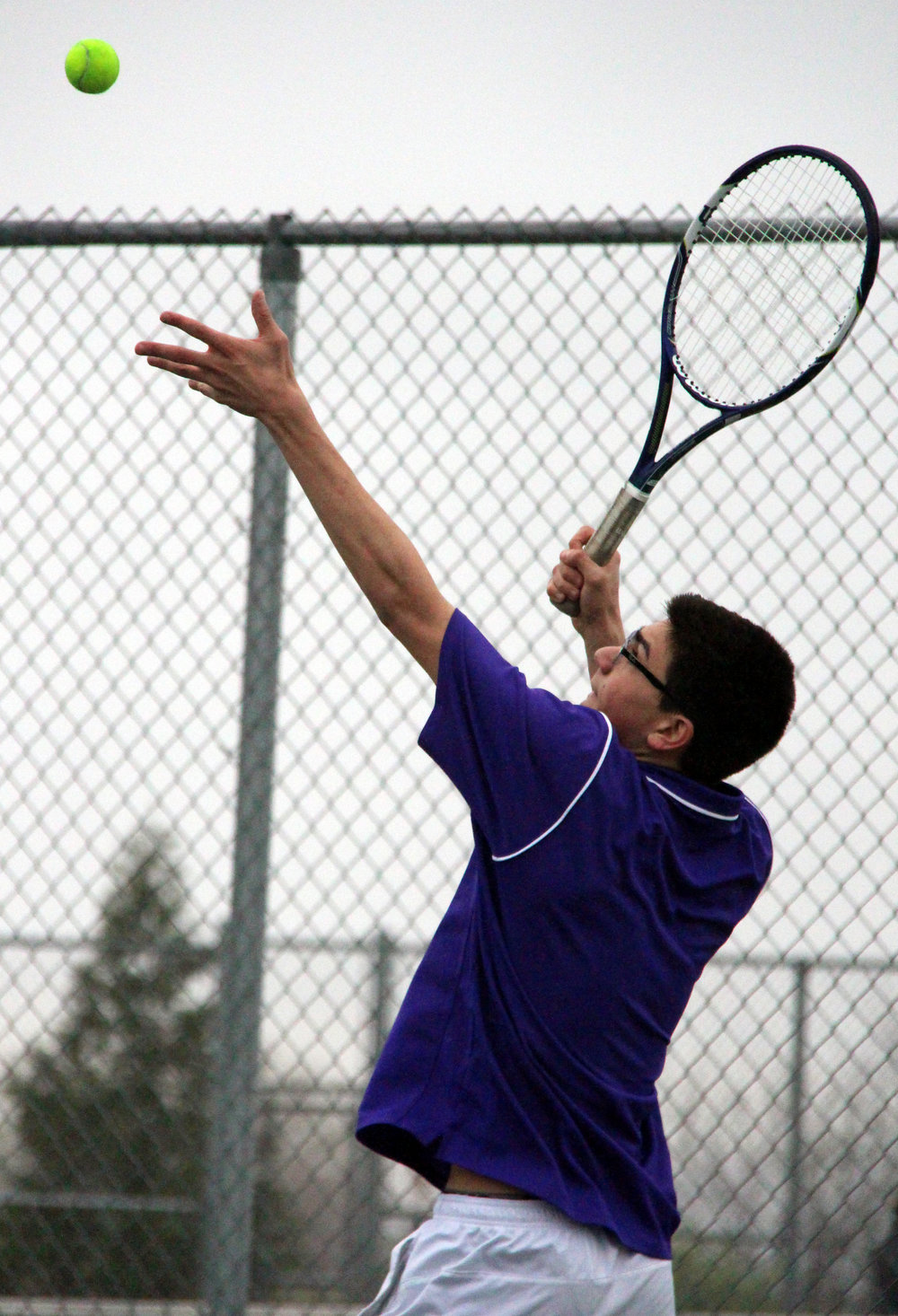 ROSS MARTIN/Citizen photo Park Hill South's Joe Badalucco prepares to hit a serve to Park Hill sophomore Cooper Hayes in a single match during a dual Thursday, March 30 at Park Hill South High School in Riverside, Mo.