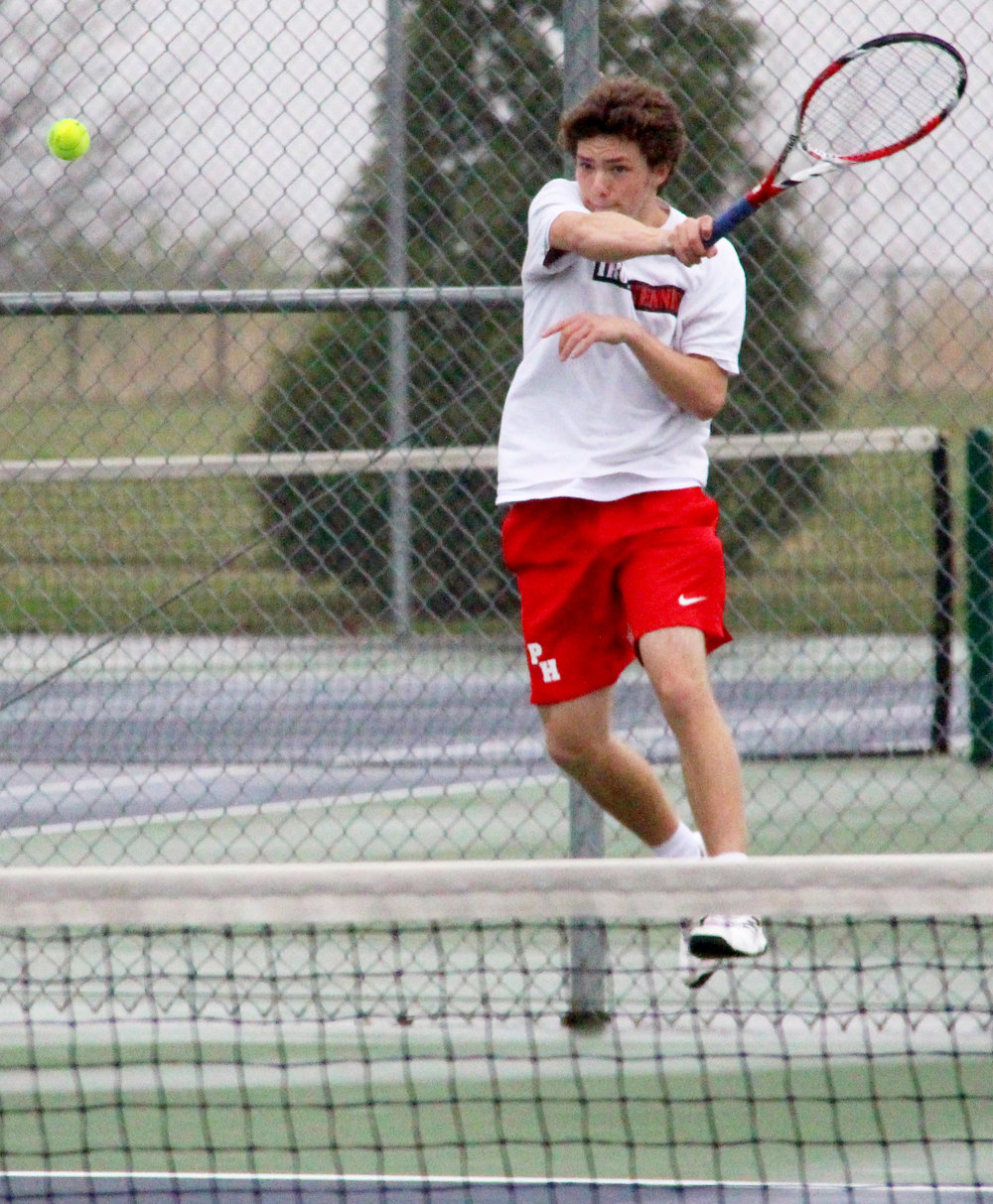 ROSS MARTIN/Citizen photo Park Hill senior Grant Martin hits a return shot in a singles match during a dual with Park Hill South on Thursday, March 30 at Park Hill South High School in Riverside, Mo.