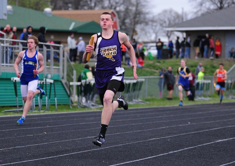 NICK INGRAM/Citizen photo North Platte junior Corbin Green, right, runs the anchor leg of the 4x200-meter relay in the Smithville Invitational on Friday, March 31 at Smithville High School in Smithville.