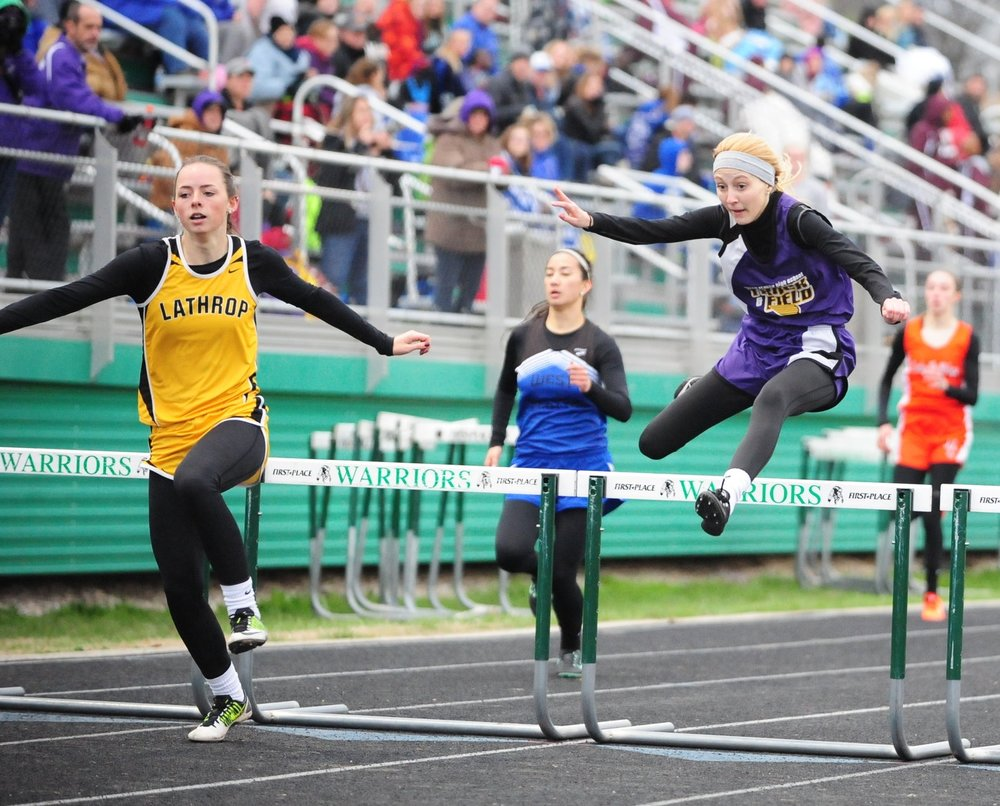 NICK INGRAM/Citizen photo North Platte junior McKenna clears a hurdle in the 300-meter hurdles race at the Smithville Invitational.