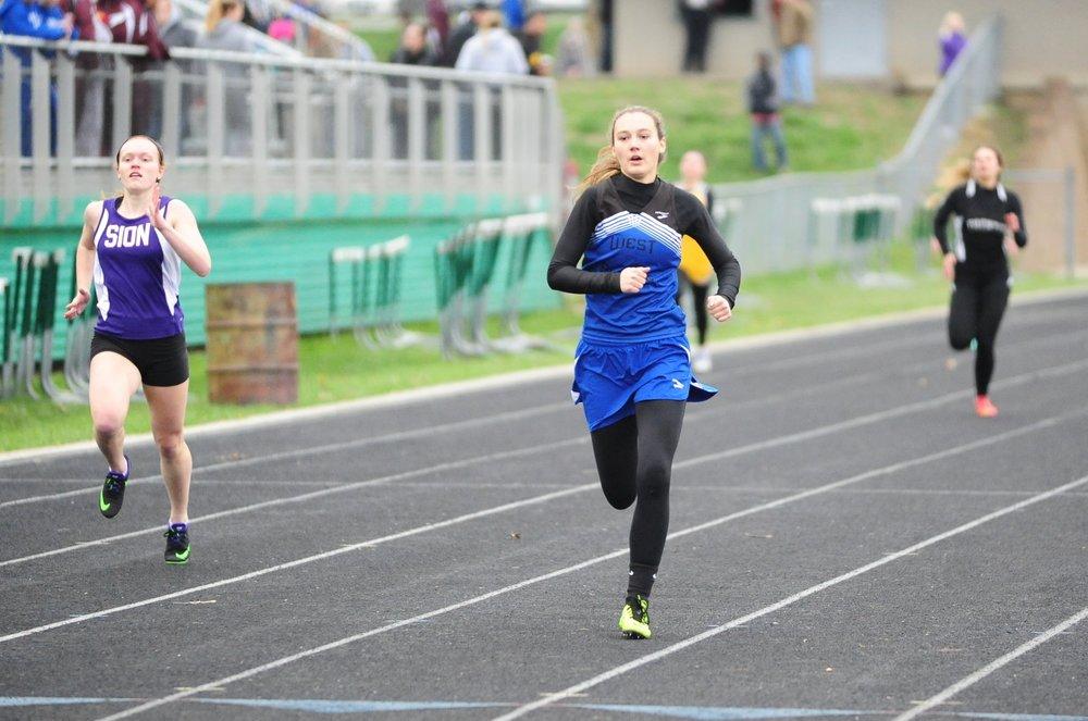 West Platte junior Ciara Davies runs the final stretch of the 400-meter run in the Smithville Invitational.