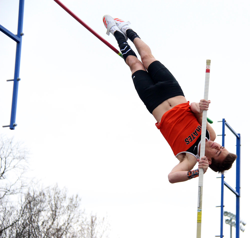 ROSS MARTIN/Citizen photo Platte County senior Bryce Bearden clears the pole vault bar during Pirate Flight Night on Friday, March 31 at Pirate Stadium. He won the competition and set a school record for a second time this season, upping his mark to 14 feet.
