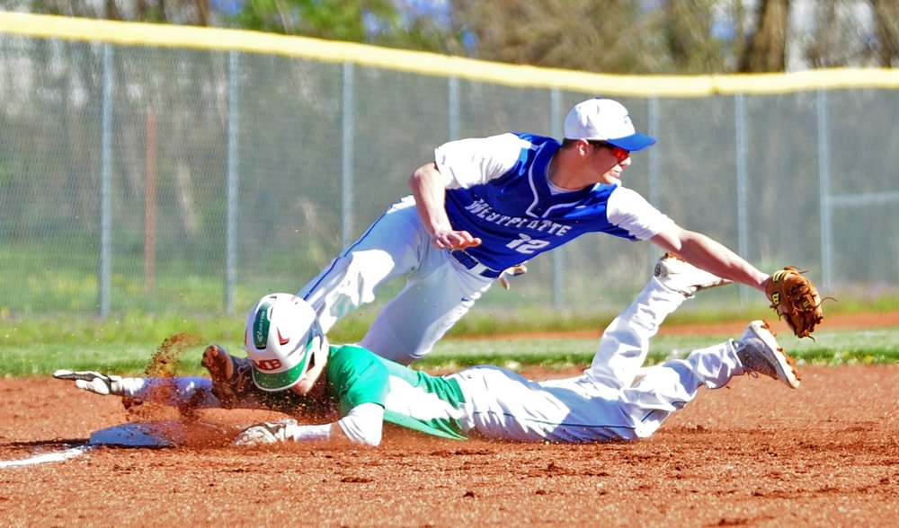 NICK INGRAM/Citizen photo West Platte junior Grant Eagen prepares to take a throw as a Mid-Buchanan runner slides safely into third base during a game Thursday, April 6 at Benner Park in Weston, Mo.