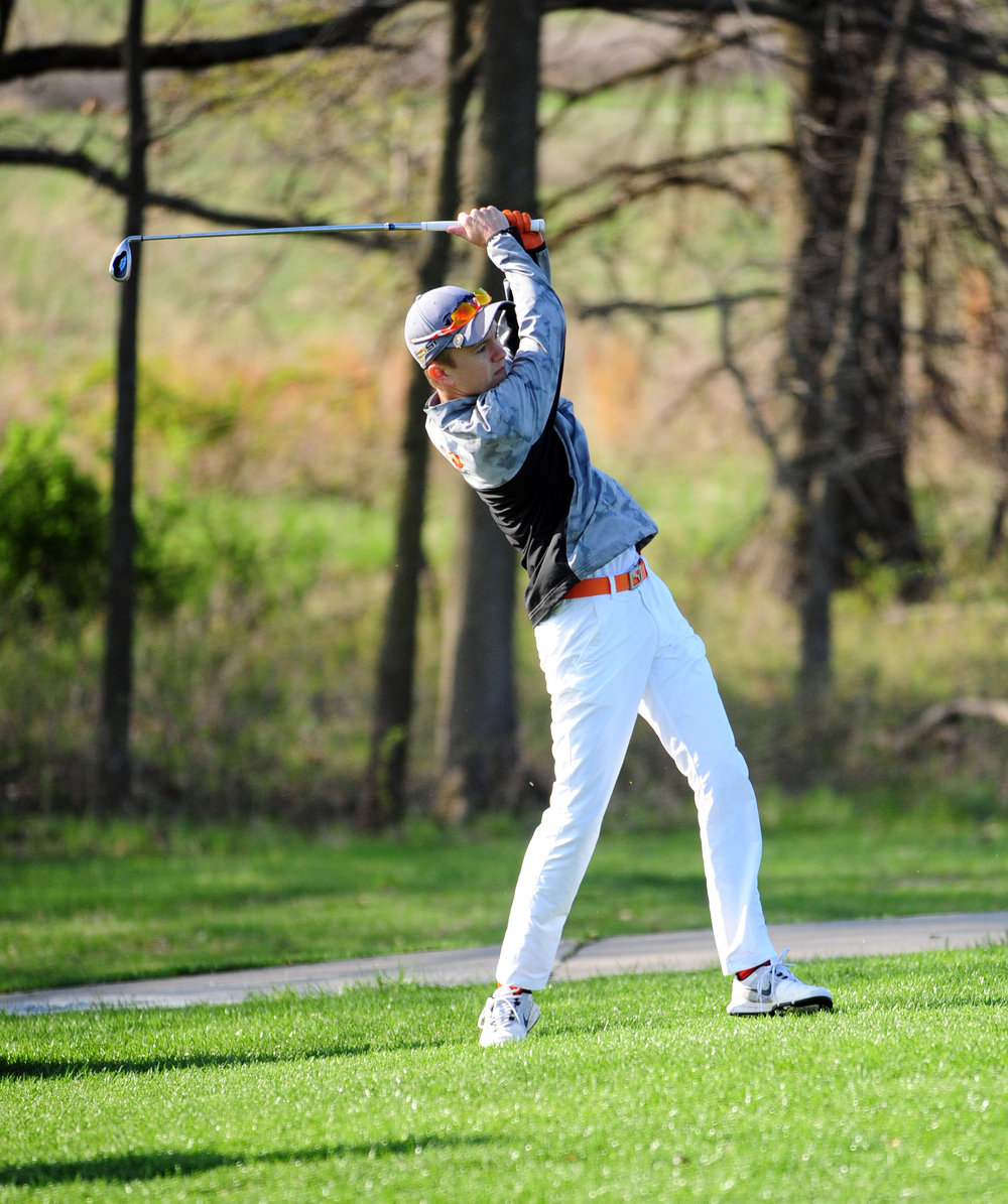 NICK INGRAM/Citizen photo Platte County senior Payton Boekhout hits an approach shot during the Oak Park Invitational on Monday, April 10 on the Posse Course at Paradise Pointe Golf Complex in Smithville, Mo.