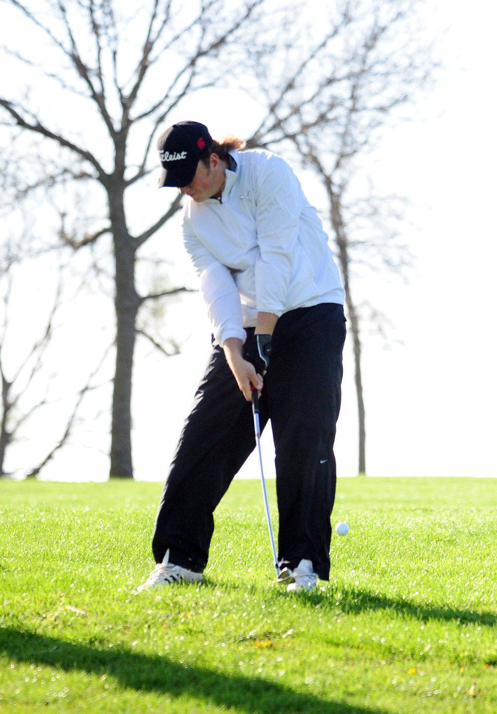 NICK INGRAM/Citizen photo Park Hill's Davin Dorrell hits an iron shot during the Oak Park Invitational on Monday, April 10 on the Posse Course at Paradise Pointe Golf Complex in Smithville, Mo.