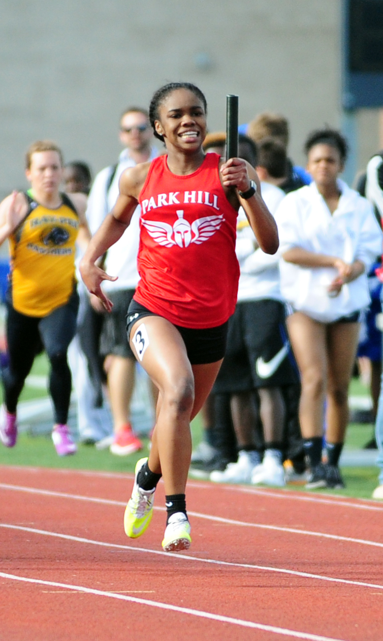 NICK INGRAM/Citizen photo Park Hill junior Taiya Shelby runs the anchor leg of the 4x200-meter relay in the Jerry Crews Invitational on Friday, April 7 at North Kansas City District Activities Complex in Kansas City, Mo.
