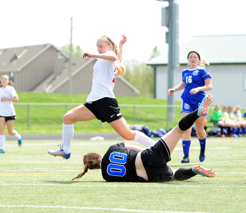 NICK INGRAM/Citizen photo Park Hill junior Alison Walls clips past the Harrisonville goalkeeper during a Smithville Invitational game played Saturday, April 8 in Smithville, Mo.
