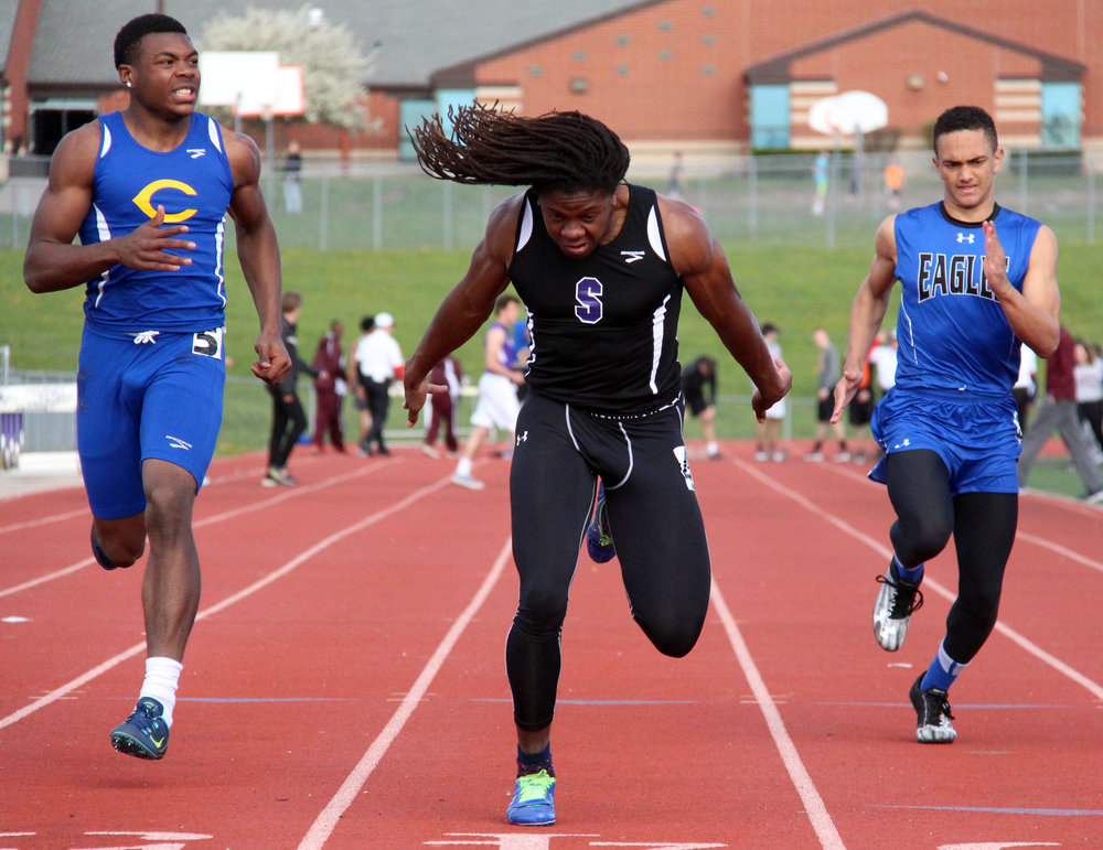 ROSS MARTIN/Citizen photos Park Hill South senior Nylo Clarke, center, crosses the finish line in 10.93 seconds to win the 100-meter dash in the Kearney Invitational on Friday, April 7 at Kearney High School in Kearney, Mo.
