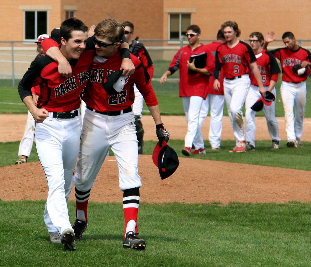 ROSS MARTIN/Citizen photo Park Hill second baseman Trevor Guzzo, left, and infielder Zayne Morrow celebrate the win the second game of a doubleheader Saturday, April 8 at Park Hill High School in Kansas City, Mo.