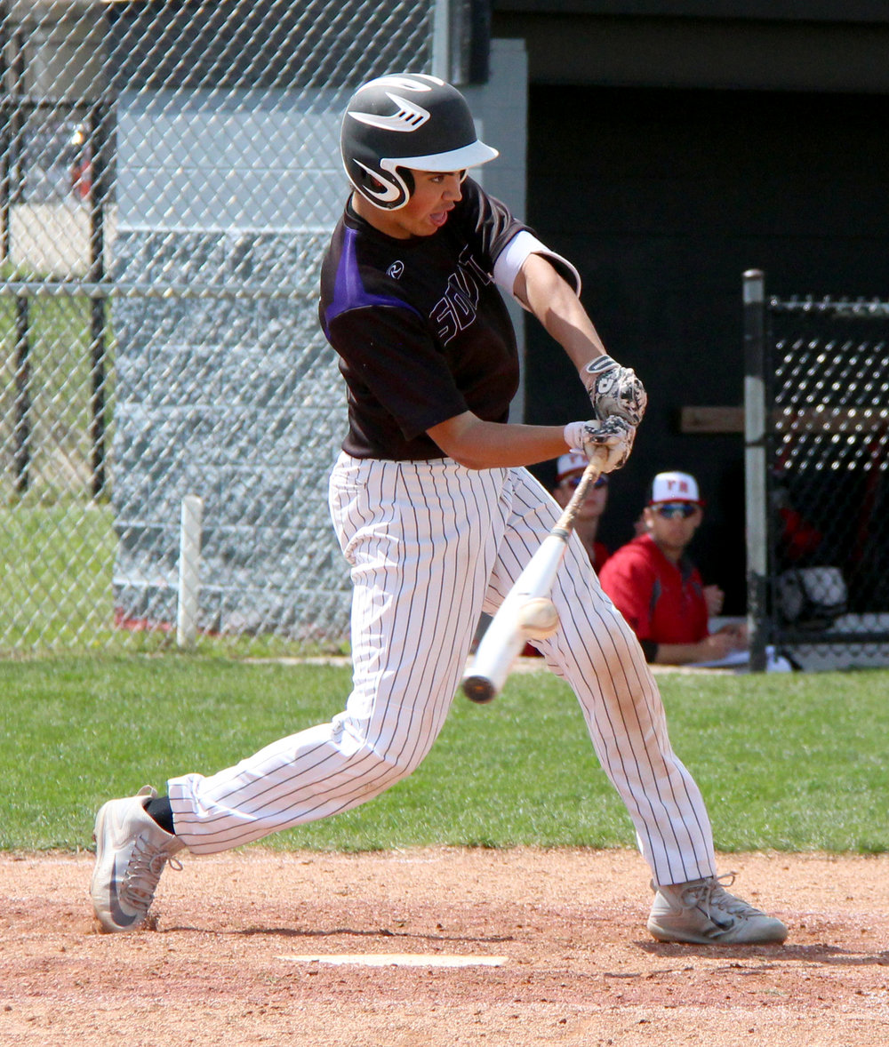 ROSS MARTIN/Citizen photo Park Hill South senior Stephen Personelli takes a swing against Park Hill on Saturday, April 8.