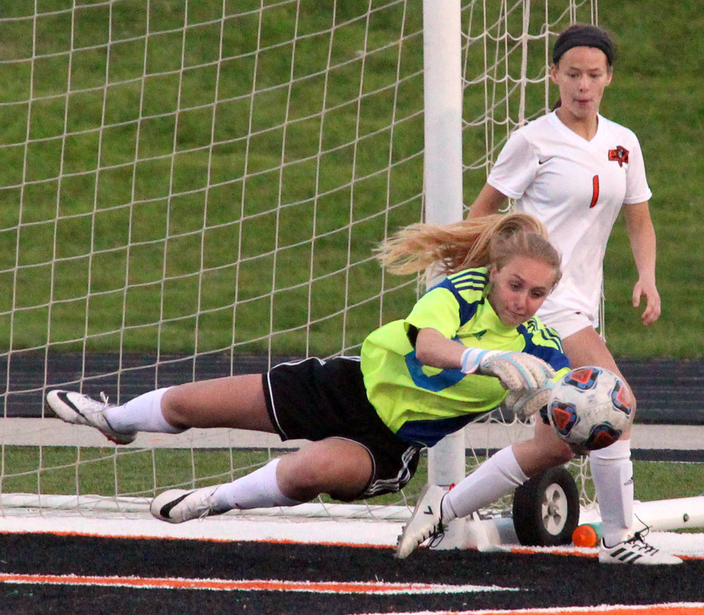 ROSS MARTIN/Citizen photo Platte County freshman goalkeeper Jaylee Wiedmer sprawls out to make a save in a match with Kearney on Monday, April 17 at Pirate Stadium.
