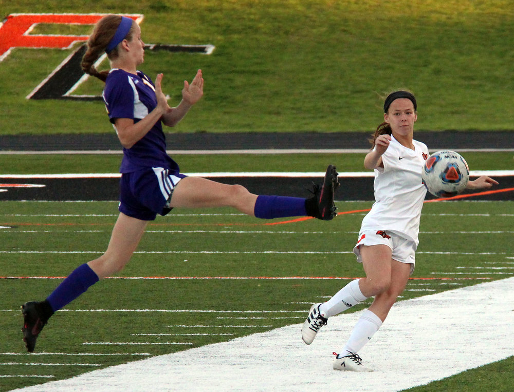 ROSS MARTIN/Citizen photo Platte County junior defender Brittany Alvarado, right, watches her clearance in a match with Kearney on Monday, April 17 at Pirate Stadium.