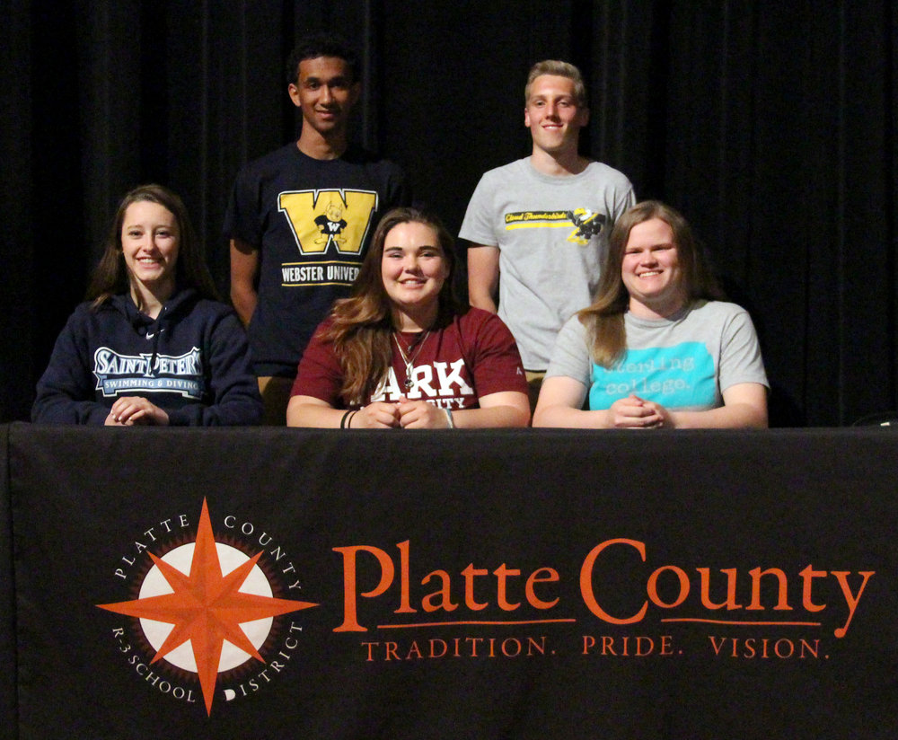 ROSS MARTIN/Citizen photo Platte County seniors (front row, from left) Rachel Valentine, Anna Townsend and Elizabeth Peterson and (back row, from left) DeAndre Rollins and Mason Hays were honored in a signing ceremony Thursday, April 13 at Platte County High School.
