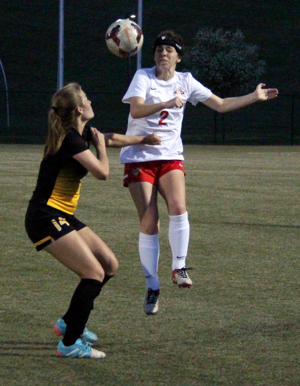 ROSS MARTIN/Citizen photo Park Hill senior defender Andie Powell (2) heads a ball away for a clearance against St. Teresa's Academy on Wednesday, April 12 at Park Hill District Soccer Complex in Riverside, Mo.
