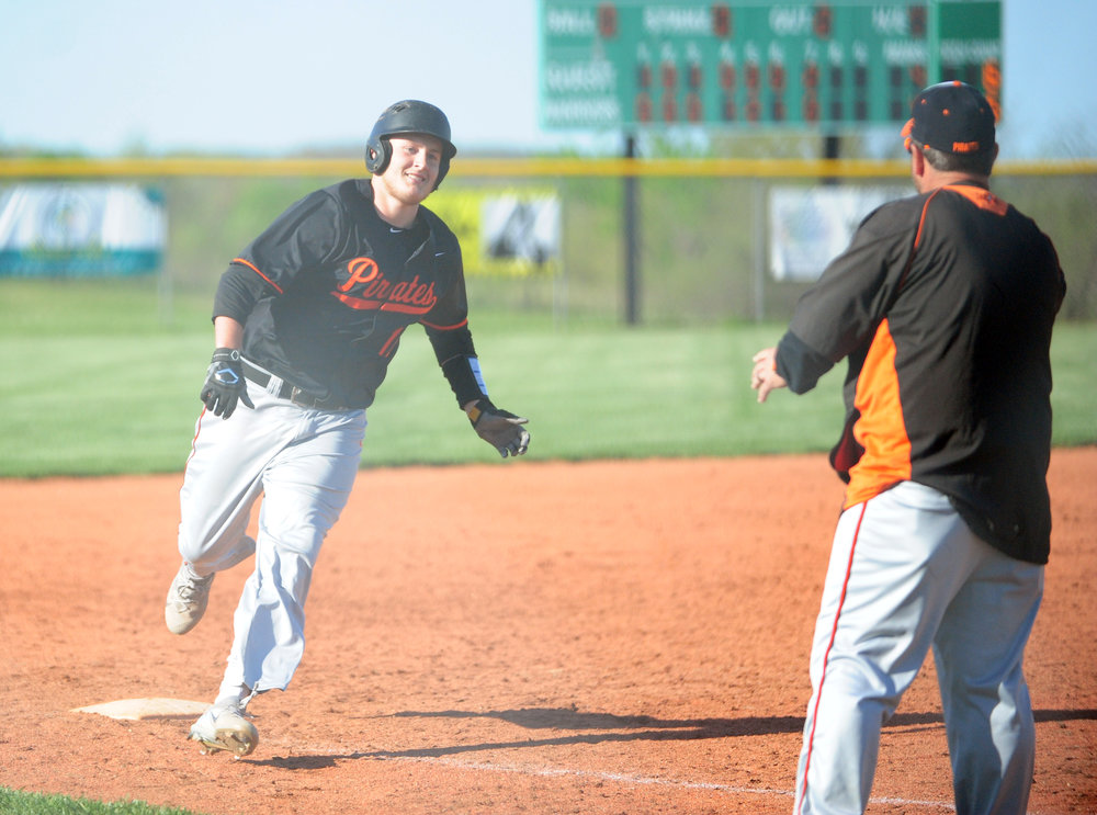 NICK INGRAM/Citizen photo Platte County senior Austin Gammill, left, rounds third base toward coach Rob Davenport after Gammill hit a walkoff two-run home run in a 6-4 win over Smithville in a Northland Tournament pool play game Monday, April 17 at Smithville High School in Smithville, Mo.