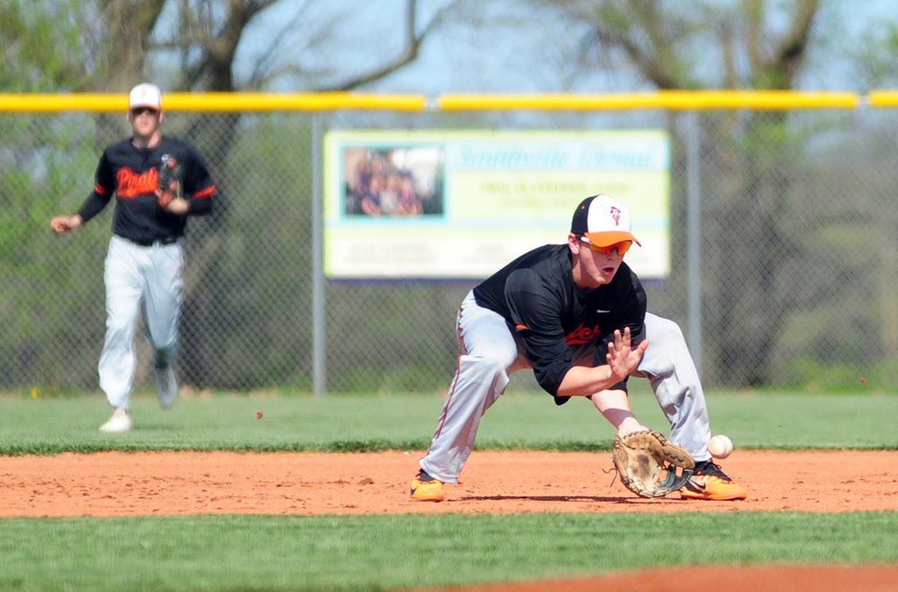 NICK INGRAM/Citizen photo Platte County senior second baseman Dillon Doll fields a grounder against Smithville in a Northland Tournament pool play game Monday, April 17 at Smithville High School in Smithville, Mo.