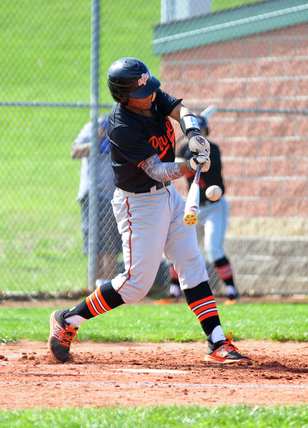 NICK INGRAM/Citizen photo Platte County junior outfielder makes contact in a game against Smithville on Monday, April 17 in Smithville, Mo.