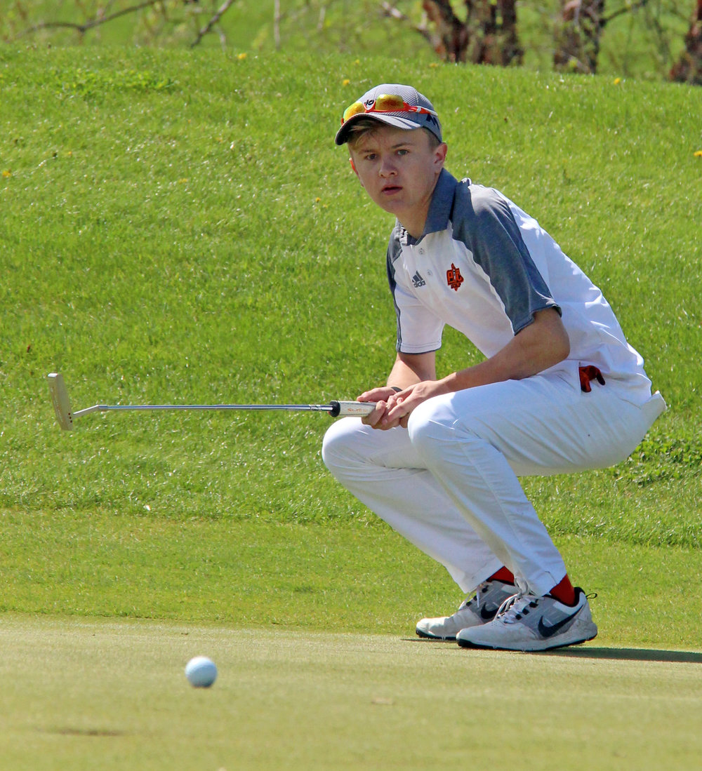 ROSS MARTIN/Citizen photo Platte County senior Payton Boekhout crouches to watch his putt on No. 16 during the Pirate Invitational on Monday, April 17 at Shiloh Springs Golf Course.