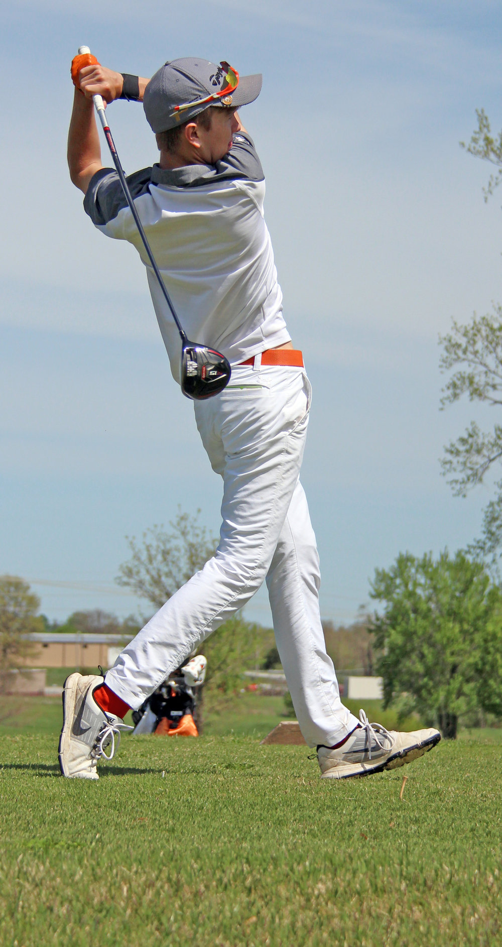 ROSS MARTIN/Citizen photo Platte County senior Payton Boekhout watches his drive on No. 17 during the Pirate Invitational on Monday, April 17 at Shiloh Springs Golf Course.