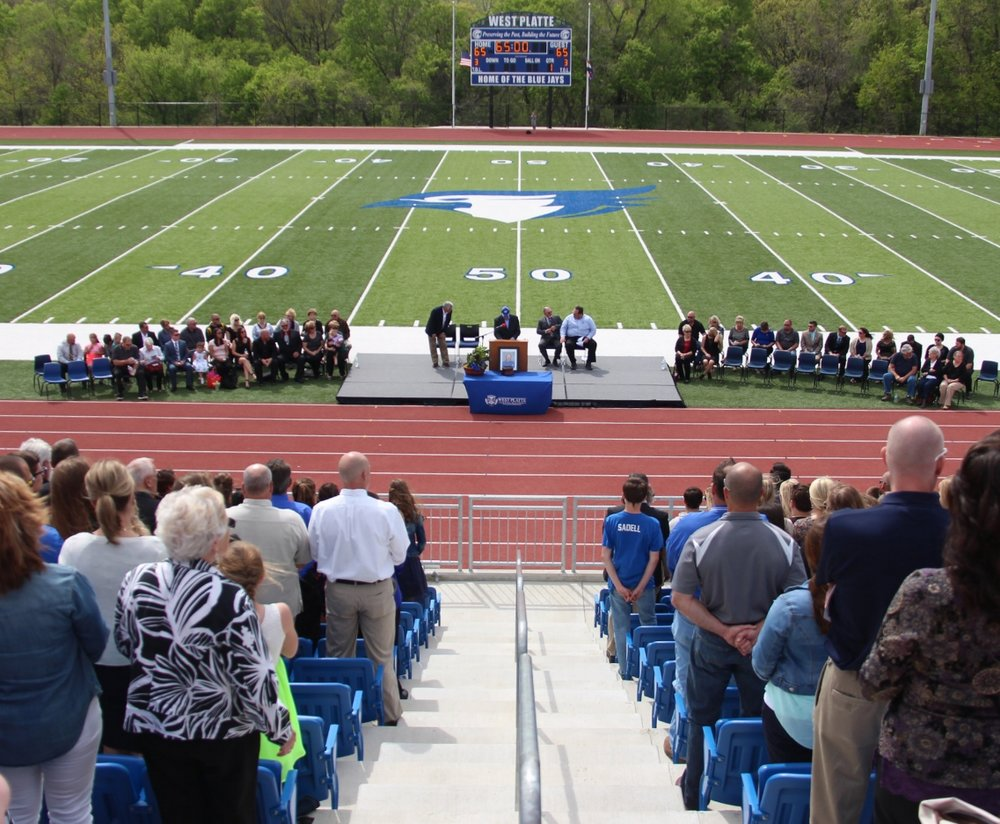 ROSS MARTIN/Citizen photo Pastor Brady Testorff of The Calling Community Church speaks during funeral services for Nate Danneman held Monday, April 24 at Rudolph Eskridge Stadium in Weston, Mo.
